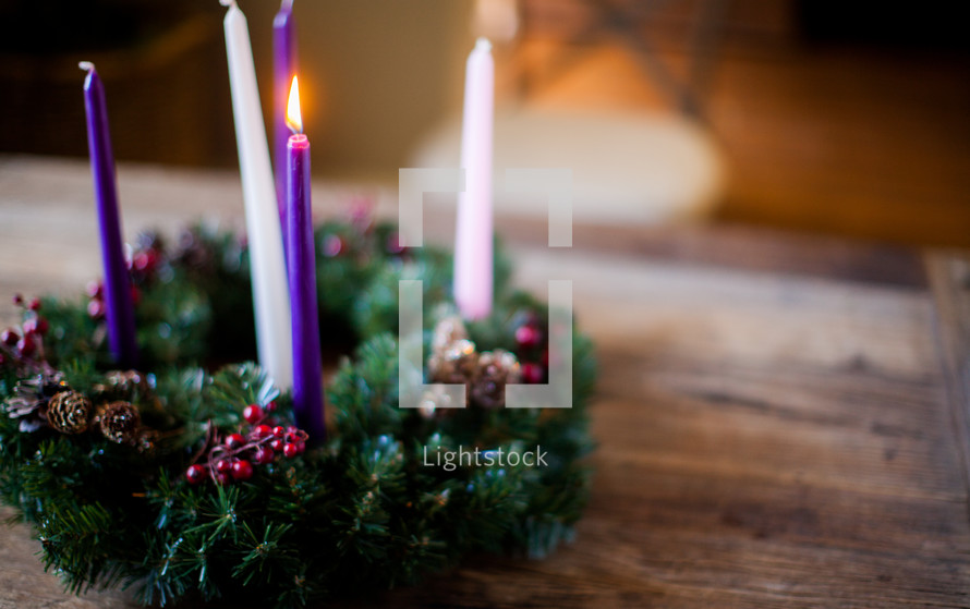 one candle lit on an Advent wreath