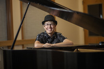 young man and a grand piano