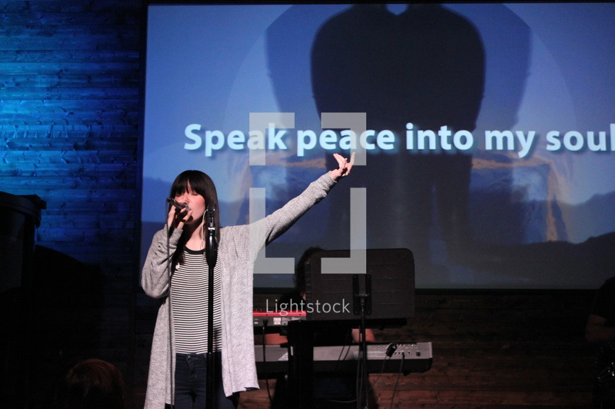 worship leader leading a congregation in song