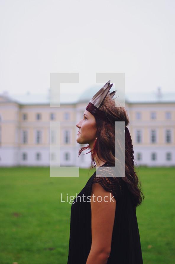 a woman wearing a Native American headdress
