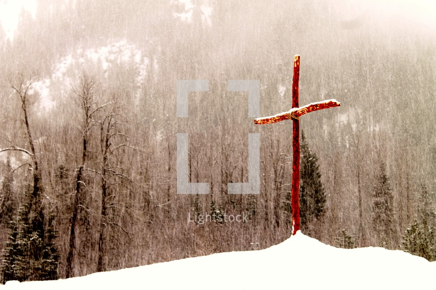 wood cross in the snow