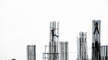 men climbing scaffolding