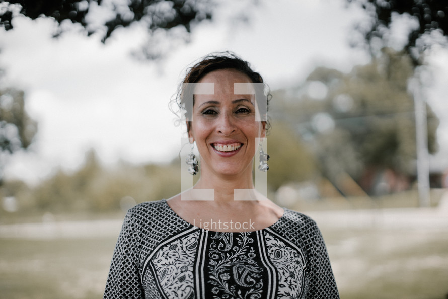 a smiling woman facing the camera
