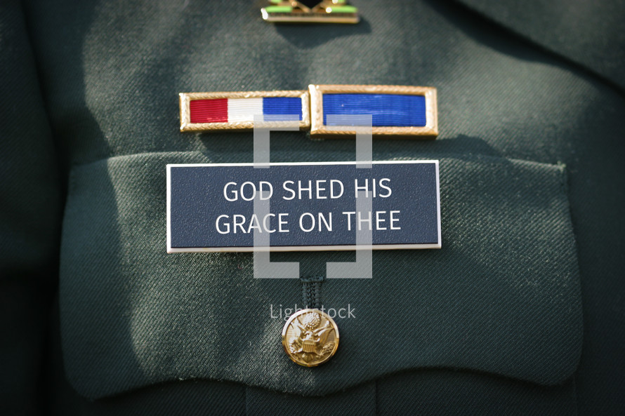 God Shed his grace on thee on a military name badge of uniform.