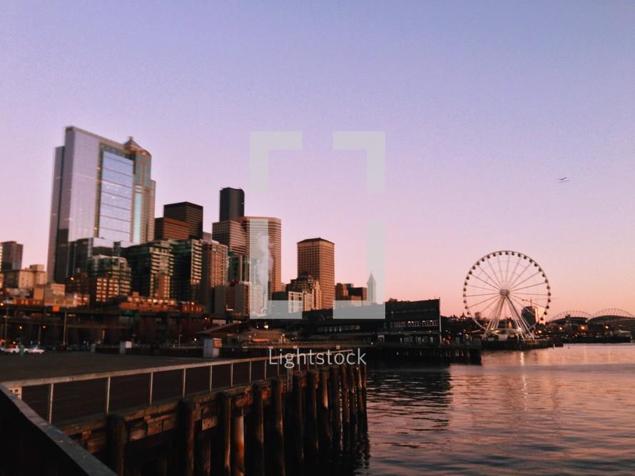 A coastal city with a ferris wheel