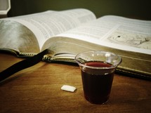 bread and wine in front of a Bible
