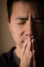 man with praying hands