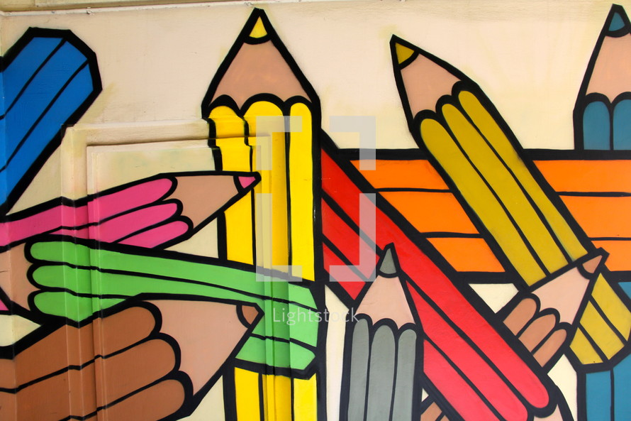 Painted mural of children's rainbow color crayons