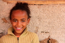 Smiling young girl child in Ethiopia, Africa