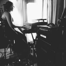woman playing a keyboard