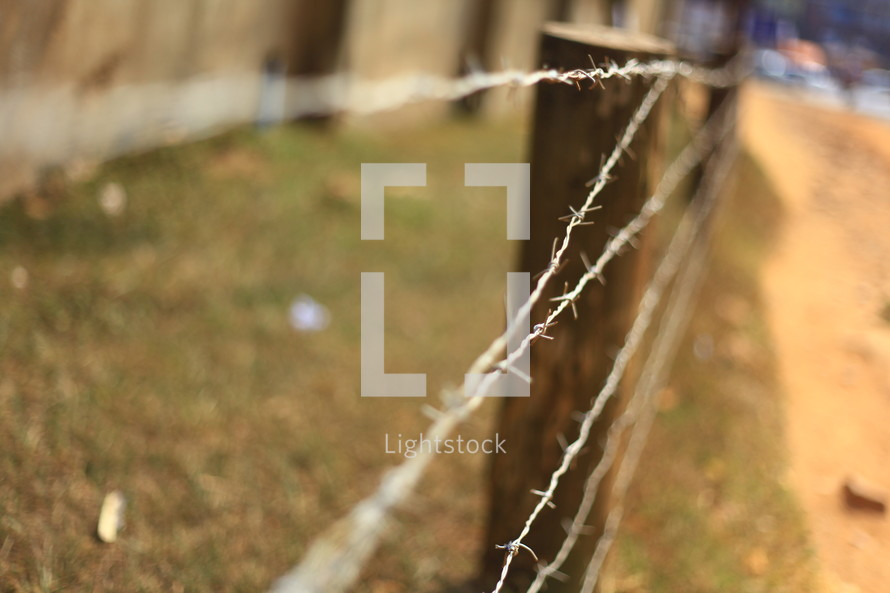 barbed wire on a fence post
