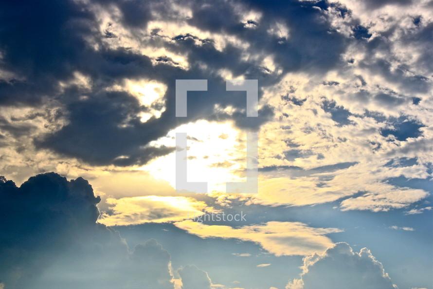 Sun shining through the clouds