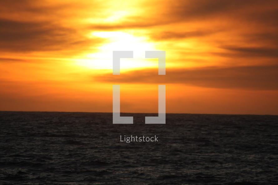 An ocean horizon with a sunset.