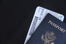 USA passport and plane ticket