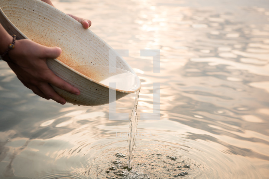 woman gathering clean water in a bowl