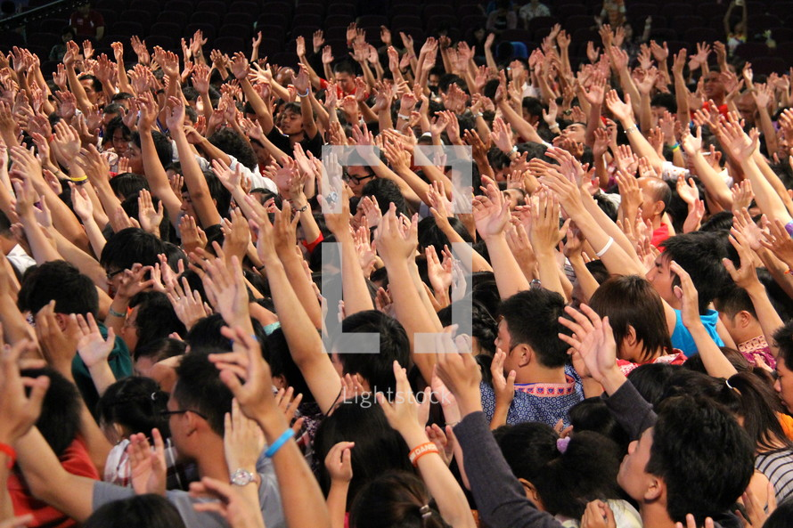 hands raised in group worship