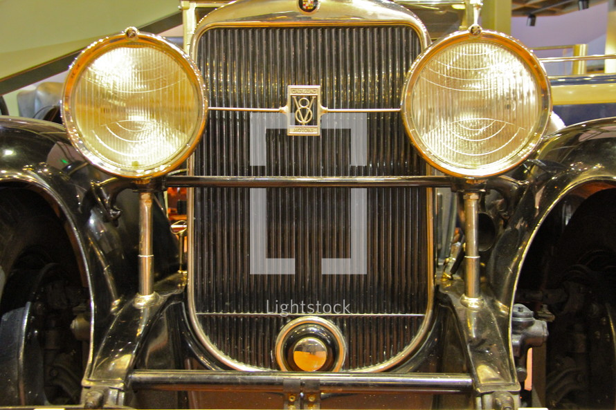 1928 V-8 Cadillac grille and headlights.