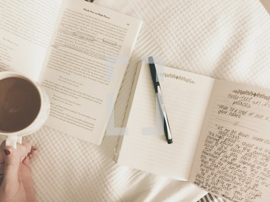 open book and notes in a journal