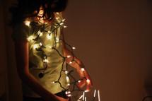 girl hanging Christmas lights