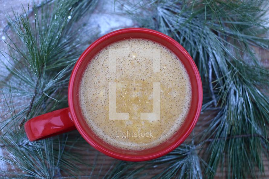 red mug and Christmas greenery