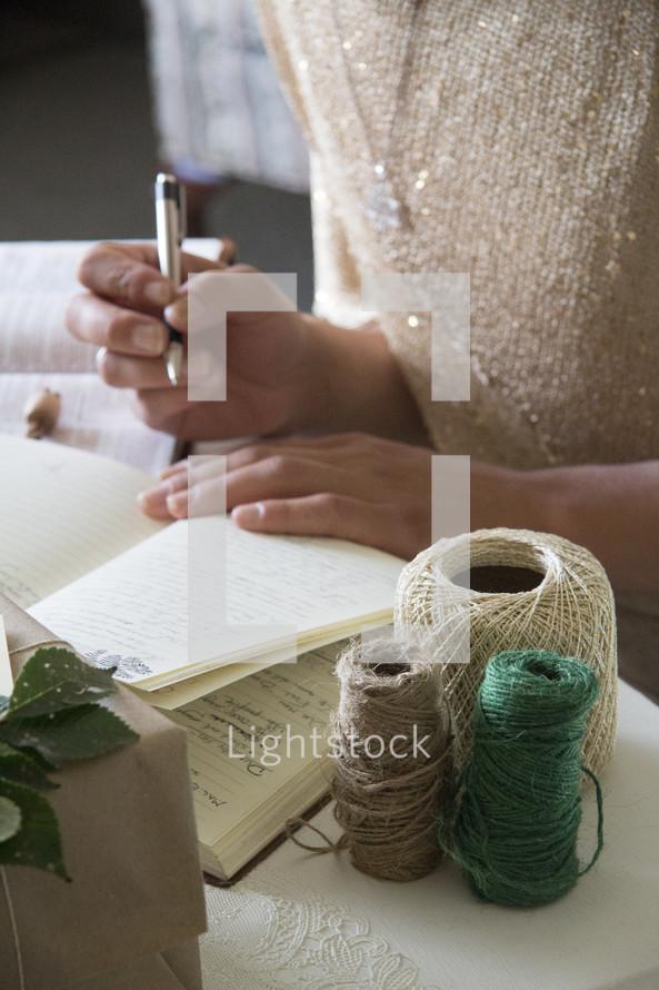 woman checking off his Christmas gift list