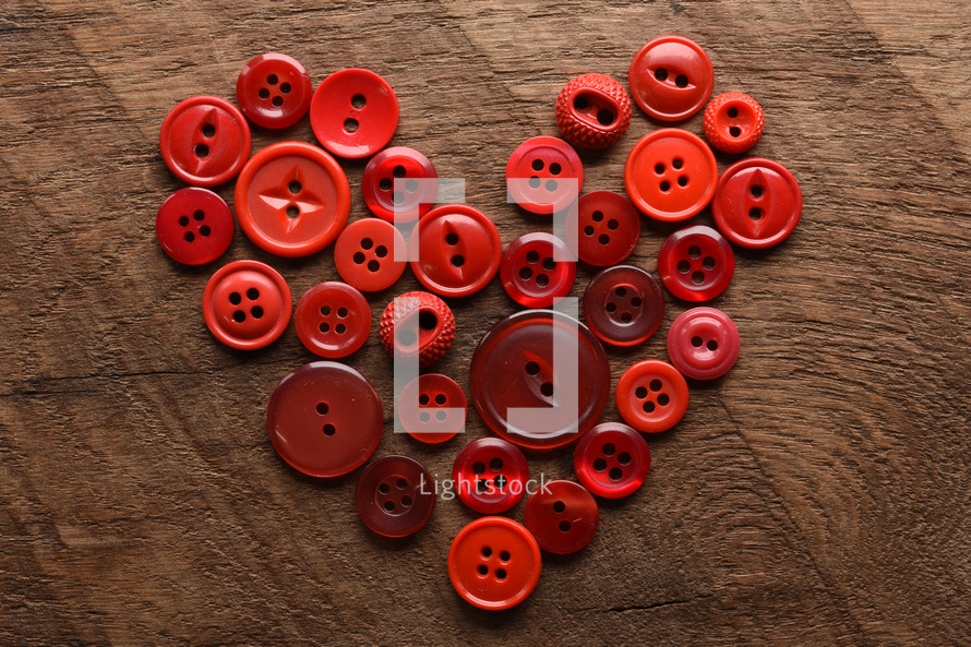 red buttons in the shape of a heart
