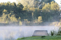 steam rising over a pond