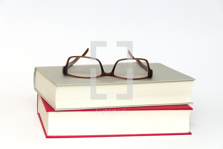 reading glasses on a stack of books