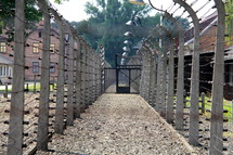 Barbed wire, electric fence and gates around a prison