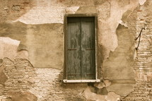Wooden window on an adobe house adjacent to the bridge of sighs