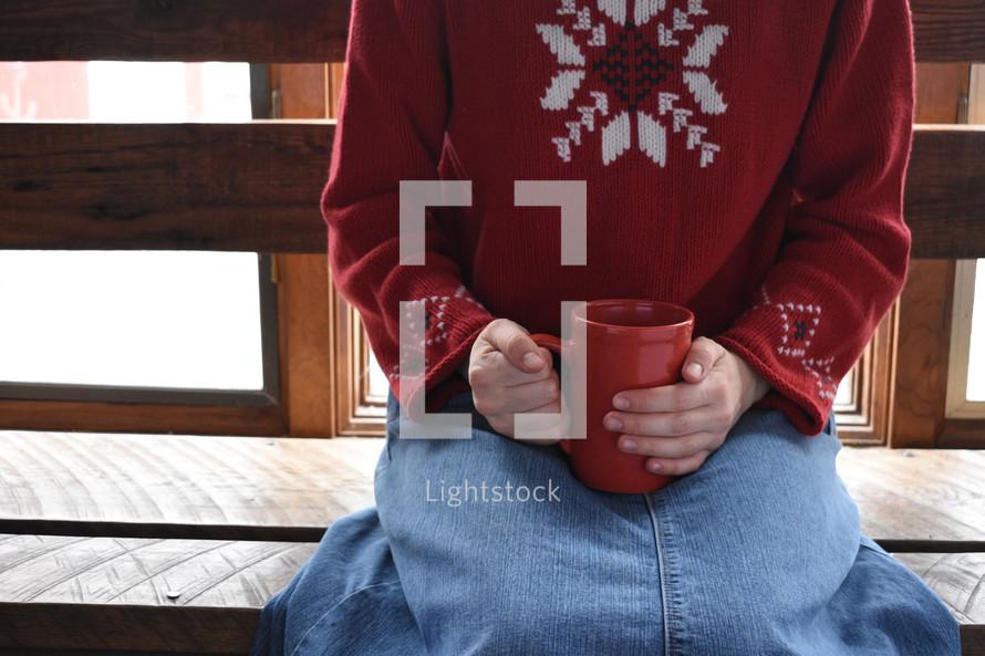 a girl with a coffee mug