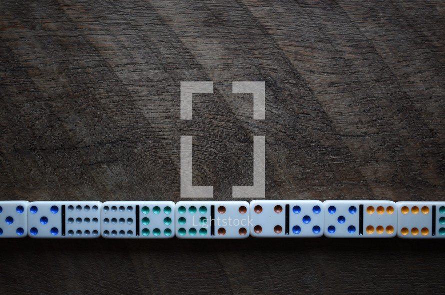 dominos against a wood background