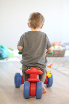 toddler riding a ride on toy