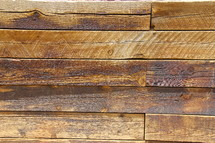 Wood planks forming panelling on a wall.