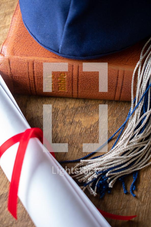 graduation cap and diploma on a Bible