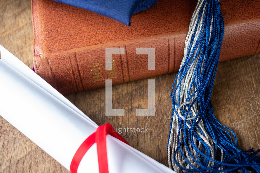 graduation cap on a Bible