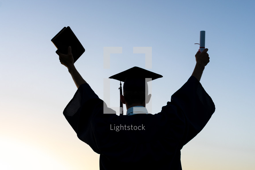 silhouette of a celebrating graduate