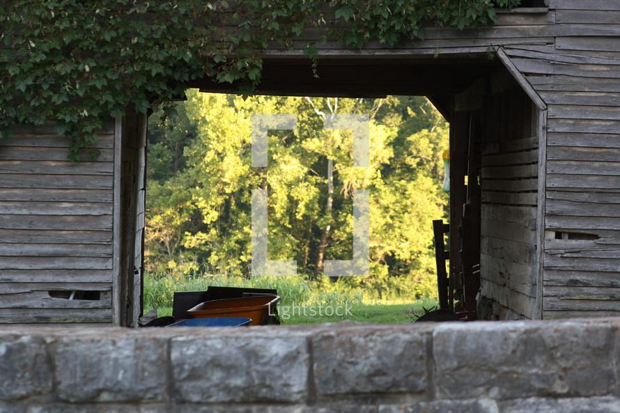 weathered barn - stone fence