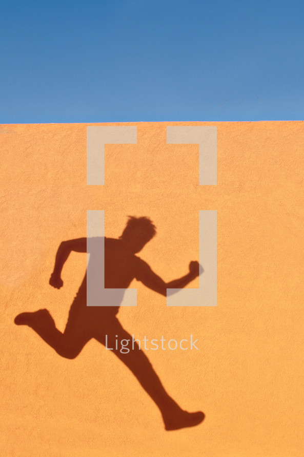 A shadow of a man running and jumping