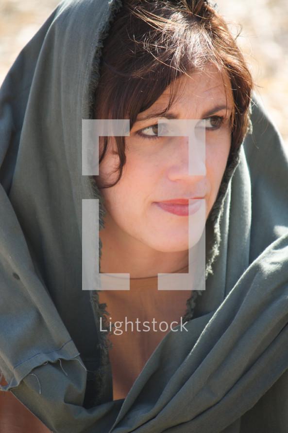 Woman wearing a head scarf.
