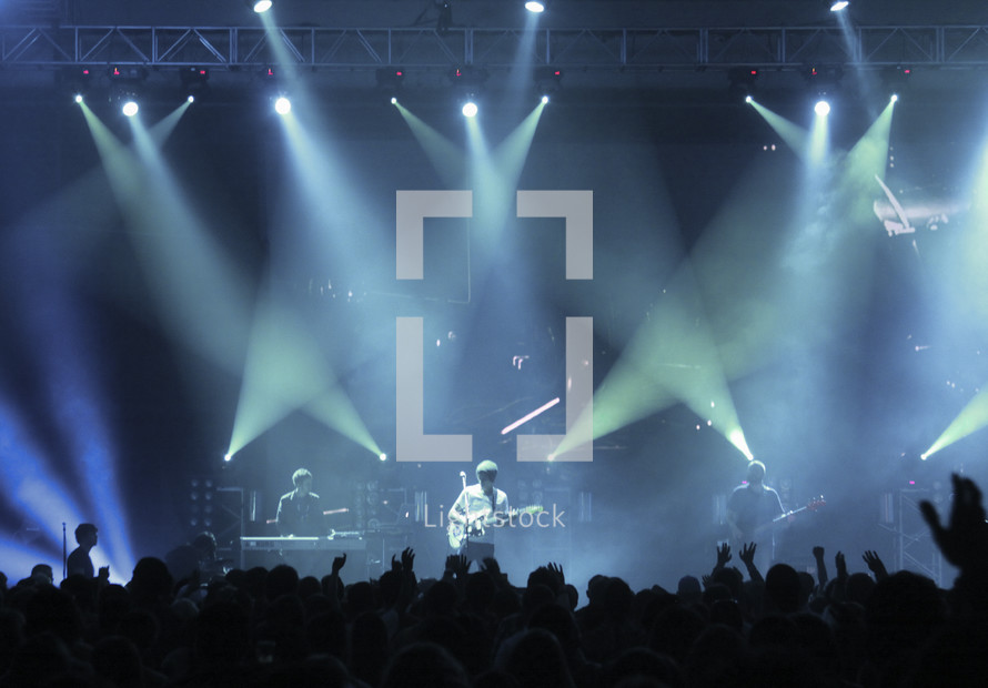 band under stage lights at a concert
