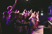raised hands at a youth worship