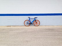 A bike parked against a wall.