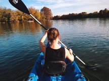 A woman paddling in a kayak