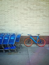 A parked bike and shopping carts.