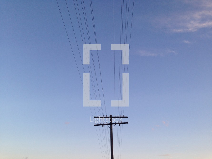 Power lines in the blue sky.