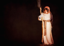 child in a Christmas pageant costume of Joseph
