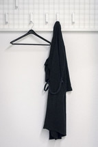 black rope hanging on a hook in a bathroom