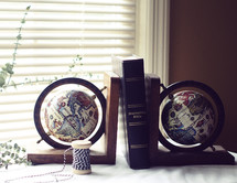 Journaling Bible between globe bookends