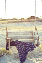 a blanket on a swing